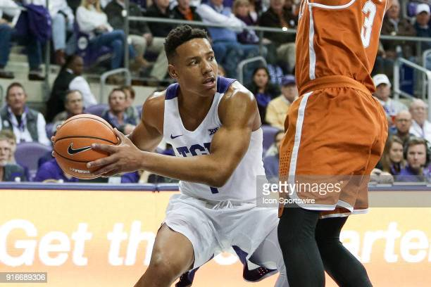 Horned Frogs guard Desmond Bane looks to pass around Texas Longhorns guard Jacob Young during the game between the Texas Longhorns and TCU Horned...