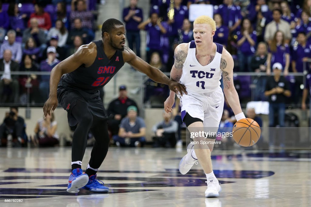 TCU Horned Frogs guard Jaylen Fisher (0) brings the ball up the court with Southern Methodist Mustangs guard Ben Emelogu II (21) defending during the game between the SMU Mustangs and TCU Horned Frogs on December 5, 2017 at Ed & Rae Schollmaier Arena in Fort Worth, TX.