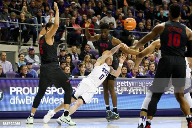 Horned Frogs guard Jaylen Fisher is fouled while trying to split the defense of Southern Methodist Mustangs forward Ethan Chargois and guard Shake...