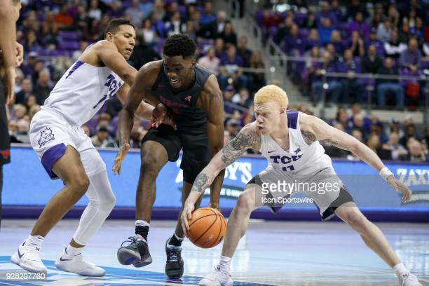 Horned Frogs guard Jaylen Fisher steals the ball from SMU Mustangs guard Shake Milton during the college basketball game between the TCU Horned Frogs...