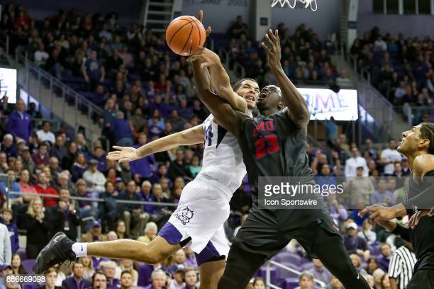 Horned Frogs guard Kenrich Williams blocks a shot by Southern Methodist Mustangs forward Akoy Agau during the game between the SMU Mustangs and TCU...