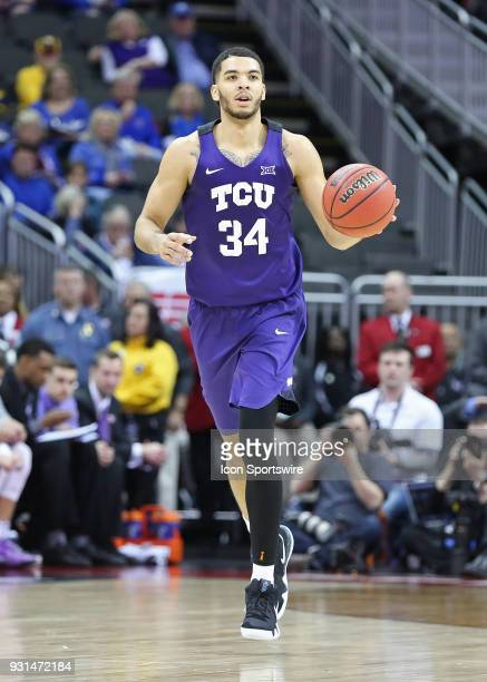Horned Frogs guard Kenrich Williams brings the ball upcourt in the second half of a quarterfinal game in the Big 12 Basketball Championship between...