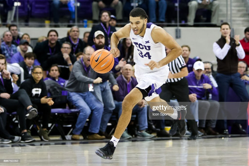 TCU Horned Frogs guard Kenrich Williams (34) comes down the court on a breakaway during the game between the SMU Mustangs and TCU Horned Frogs on December 5, 2017 at Ed & Rae Schollmaier Arena in Fort Worth, TX.