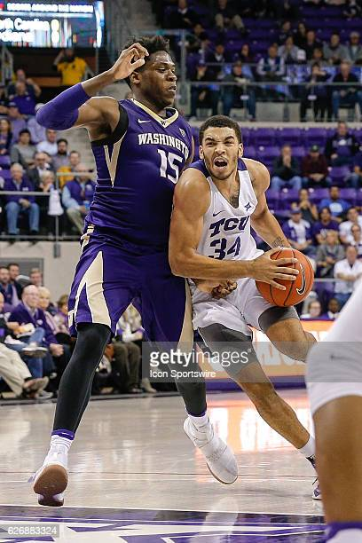Horned Frogs guard Kenrich Williams drives around Washington Huskies forward Noah Dickerson during the NCAA Basketball game between the Washington...