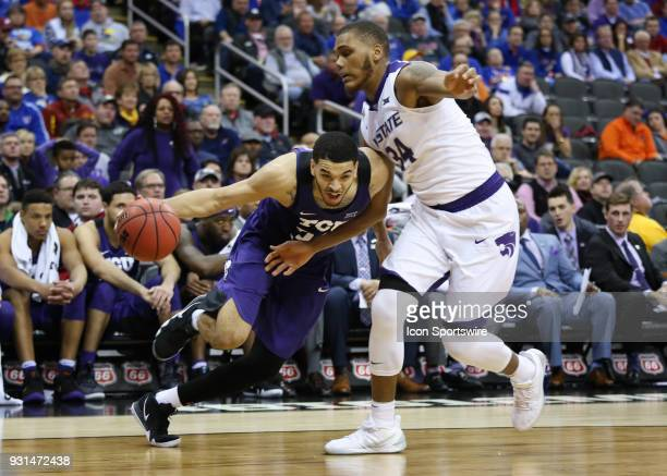 Horned Frogs guard Kenrich Williams gets low to drive against Kansas State Wildcats forward Levi Stockard III in overtime of a quarterfinal game in...