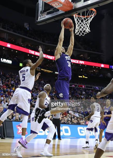 Horned Frogs guard Kenrich Williams goes inn for a dunk in the second half of a quarterfinal game in the Big 12 Basketball Championship between the...