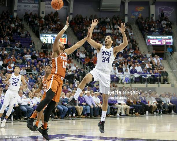 Horned Frogs guard Kenrich Williams loses control of the ball with Texas Longhorns guard Eric Davis Jr defending during the game between the Texas...
