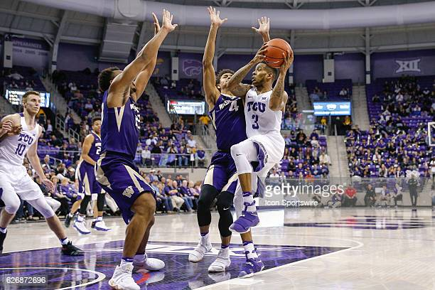 Horned Frogs guard Malique Trent drives to the basket around Washington Huskies forward Matisse Thybulle during the NCAA Basketball game between the...