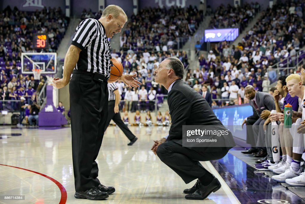 TCU Horned Frogs head coach Jamie Dixon talks with the referee during the game between the SMU Mustangs and TCU Horned Frogs on December 5, 2017 at Ed & Rae Schollmaier Arena in Fort Worth, TX.