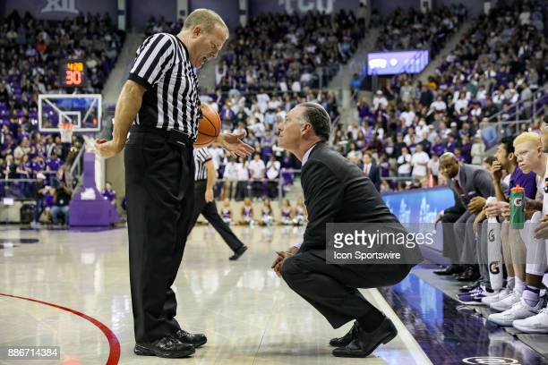 Horned Frogs head coach Jamie Dixon talks with the referee during the game between the SMU Mustangs and TCU Horned Frogs on December 5 2017 at Ed Rae...