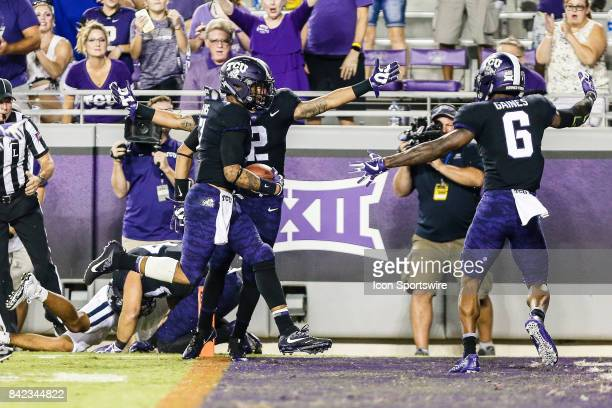 Horned Frogs linebacker Arico Evans picks up a fumble and runs in the end zone for a touchdown during the game between the TCU Horned Frogs and the...
