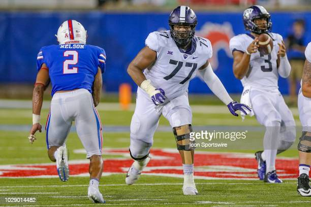 Horned Frogs offensive tackle Lucas Niang drops to block Southern Methodist Mustangs safety Patrick Nelson during the football game between the TCU...