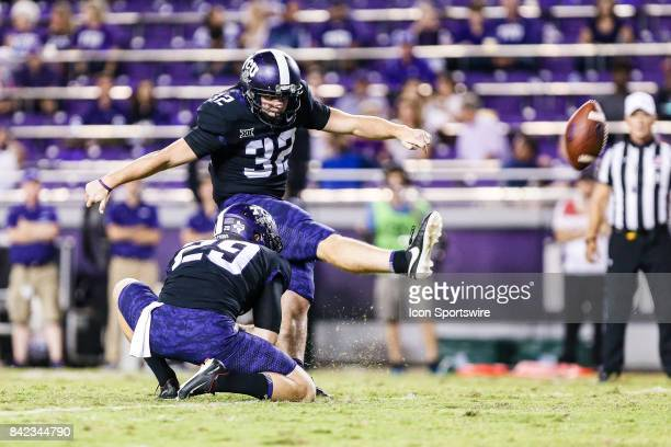 Horned Frogs placekicker Brandon Richie kicks an extra point as punter Adam Nunez holds during the game between the TCU Horned Frogs and the Jackson...