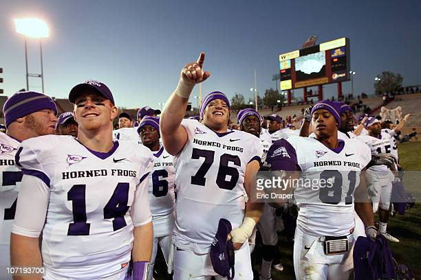 Horned Frogs quarterback Andy Dalton center Jake Kirkpatrick and wide receiver Alonzo Adams celebrate their 6617 win over the University of New...