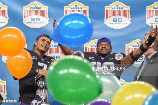 Horned Frogs quarterback Kenny Hill and TCU Horned Frogs linebacker Travin Howard celebrate their win as the confetti and balloons fall from the...