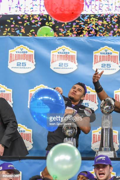 Horned Frogs quarterback Kenny Hill bats a balloon out over his teammates during post game festivities following the Alamo Bowl game between the...