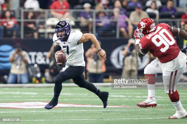 Horned Frogs quarterback Kenny Hill is flushed out of the pocket by Oklahoma Sooners defensive tackle Neville Gallimore during the Big 12...