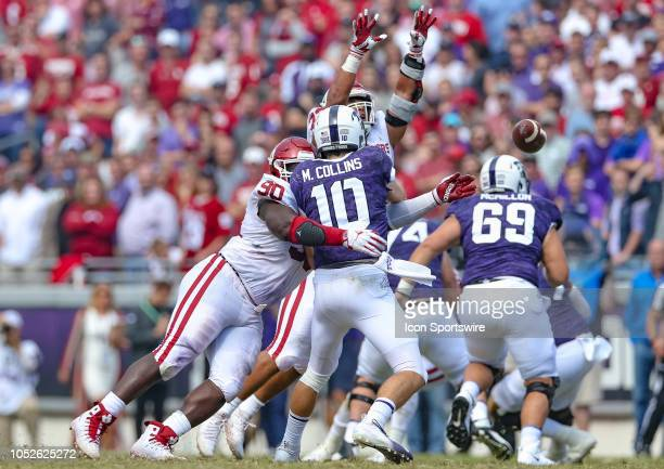 Horned Frogs quarterback Michael Collins barely gets the pass away with Oklahoma Sooners defensive lineman Neville Gallimore pressure during the game...