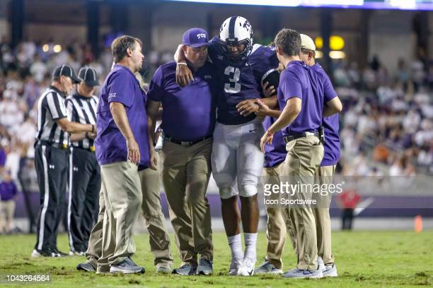 Horned Frogs quarterback Shawn Robinson is helped off the field after suffering a left arm injury late in the game between the TCU Horned Frogs and...