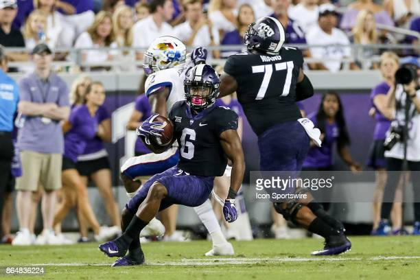 Horned Frogs running back Darius Anderson cuts back behind a block from offensive tackle Lucas Niang during the football game between the Kansas...