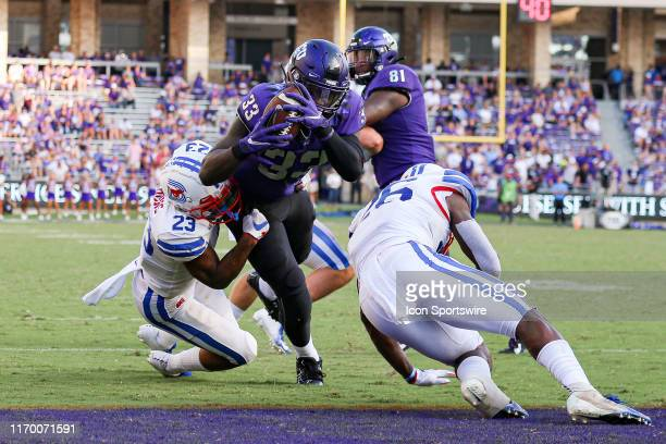 Horned Frogs running back Sewo Olonilua fights for a touchdown late in the game between the TCU Horned Frogs and SMU Mustangs on September 21, 2019...
