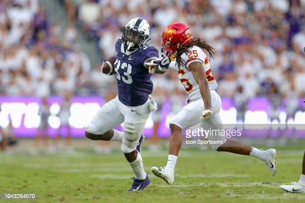 Horned Frogs running back Sewo Olonilua stiff arms Iowa State Cyclones defensive back Datrone Young during the game between the TCU Horned Frogs and...