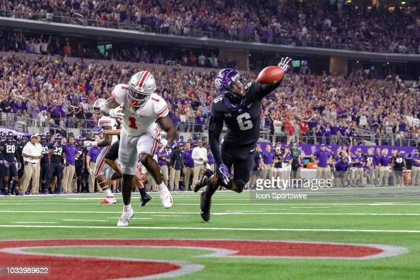 Horned Frogs safety Innis Gaines leaps in front of Ohio State Buckeyes wide receiver Johnnie Dixon during the AdvoCare Showdown between the TCU...
