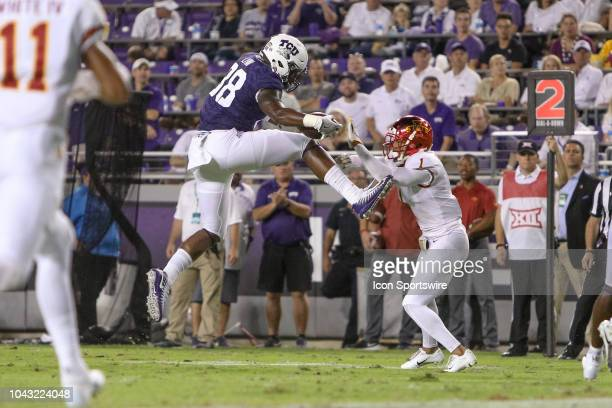 Horned Frogs tight end Artayvious Lynn attempts to leap over Iowa State Cyclones defensive back D'Andre Payne during the game between the TCU Horned...