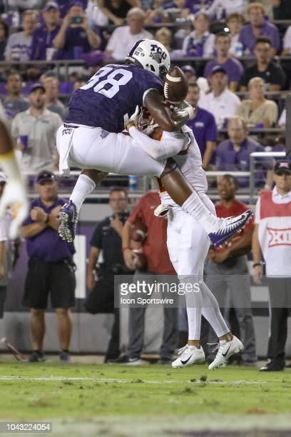 Horned Frogs tight end Artayvious Lynn attempts to leap over Iowa State Cyclones defensive back D'Andre Payne but fumbles the ball during the game...