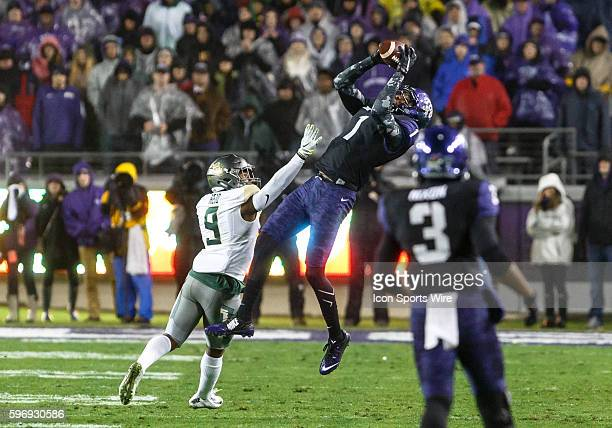 Horned Frogs wide receiver Emanuel Porter leaps to catch a deep pass over Baylor Bears cornerback Ryan Reid during the NCAA Big 12 football game...