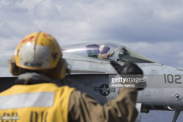 Hornet aircraft is launched off the deck of US aircraft carrier USS George Washington during its mission in the eastern Mediterranean Sea on February...