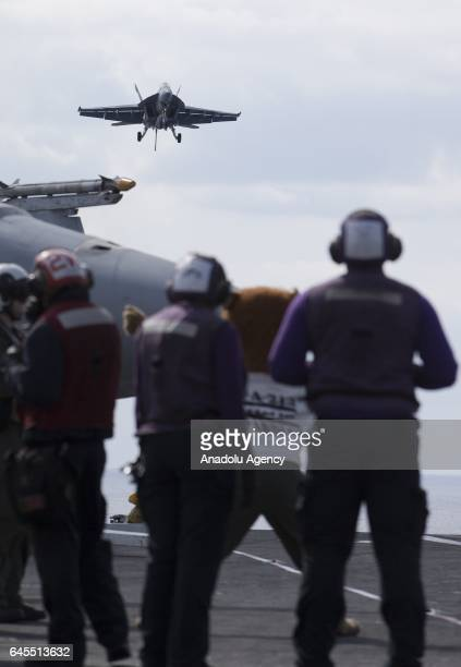 Hornet aircraft lands on the deck of the US aircraft carrier USS George Washington during its mission in the eastern Mediterranean Sea on February 21...