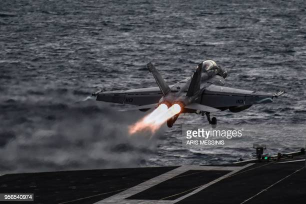 Hornet fighter jet pilot takes off from the deck of the US navy aircraft carrier USS Harry S Truman in the eastern Mediterranean Sea on May 8 2018...