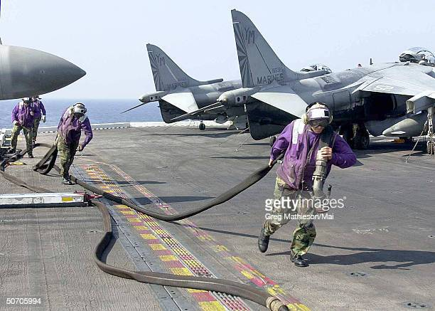 Hornet from the Thunderbolts of Fighter Attack Squadron Two Five One launching fr the flight deck of USS Theodore Roosevelt while the Dutch ship...