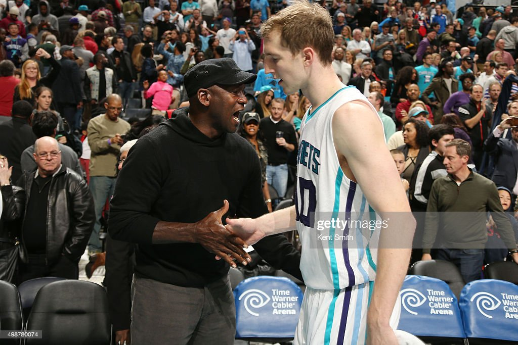 Hornets owner Michael Jordan high fives Cody Zeller #40 after the game against the Washington Wizards during the game on November 25, 2015 at Time Warner Cable Arena in Charlotte, North Carolina.