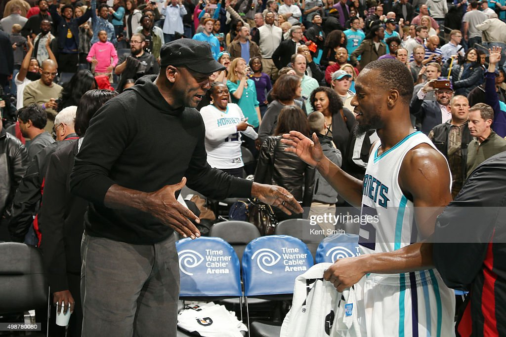 Hornets owner Michael Jordan high fives Kemba Walker #15 after the game against the Washington Wizards during the game on November 25, 2015 at Time Warner Cable Arena in Charlotte, North Carolina.