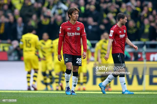 Horoshi Kiyotake of Hannover looks dejected during the Bundesliga match between Hannover 96 and Borussia Dortmund at HDIArena on March 21 2015 in...
