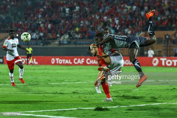 Horoya Gk Moussa Camara Fight for the ball with Ahly Olid Azaro during the CAF Champions League Quarterfinal football match between AlAhly vs Horoya...