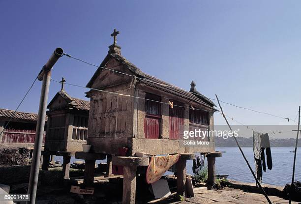 ´Horreos´ next to the sea View of three horreos next to the sea Cambarro provincia de Pontevedra