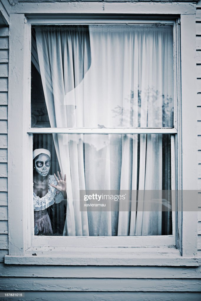 Horror behind the window : Stock Photo