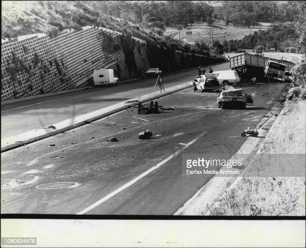 Horror car smash at Mount Ousley yesterday.***** night's tragedy.The accident left a path of twisted wreckage in its wake as the runaway semi-trailer...