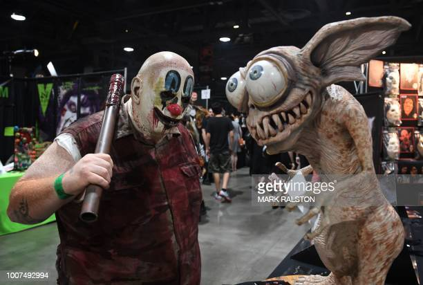 A horror movie fan poses in costume at the annual 'Midsummer Scream Horror Convention' in Long Beach California on July 29 2018 The twoday event...
