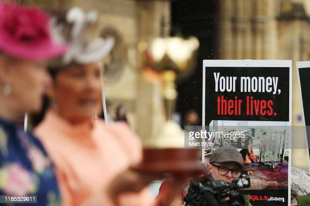 Horse activists protest as VRC Chairman Amanda Elliott and Lord Mayor of Melbourne Sally Capp display the Melbourne Cup during the 2019 Melbourne Cup...