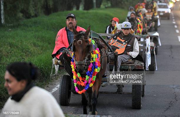 A horse and a cart are seen on February 26 in Bogota Colombia during a caravan of 50 recyclers pickers and loaders on horsedrawn carts who will...