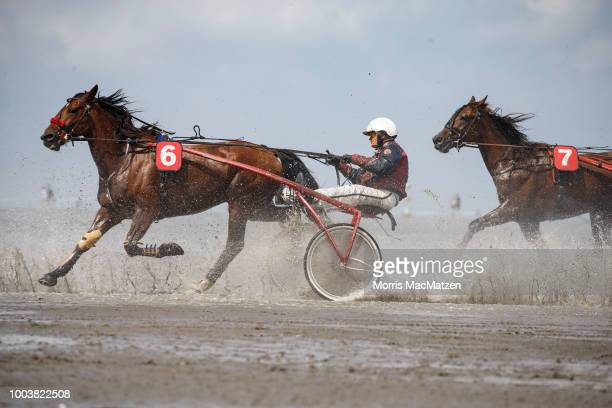 Horse and buggy teams compete in the annual horse buggy races on the mudflats at Duhnen on July 22 2018 in Cuxhaven Germany The races which in German...