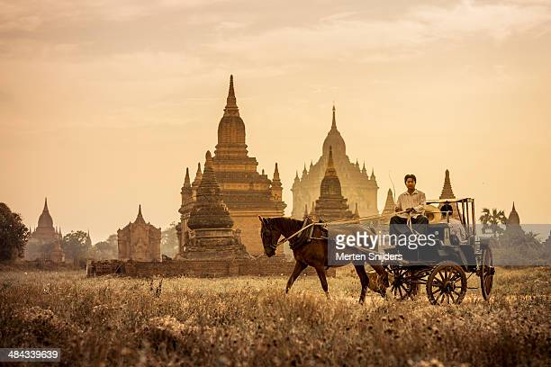 Horse and carriage turning by temples