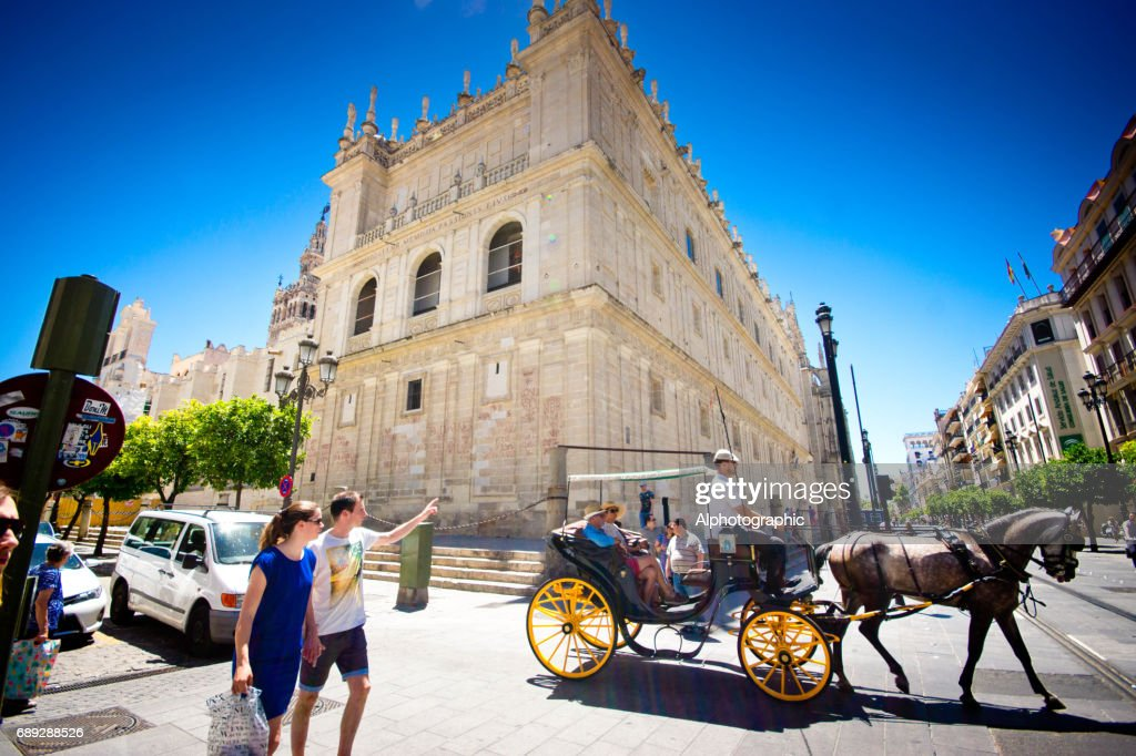 Horse and carriages with tourists : Stock Photo