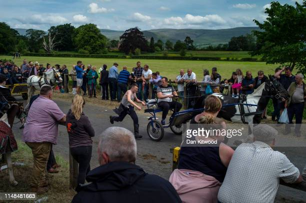 Horse and cart is driven down the 'mad mile' during the annual Appleby Horse Fair on June 07, 2019 in Appleby-in-Westmorland, England. The annual...