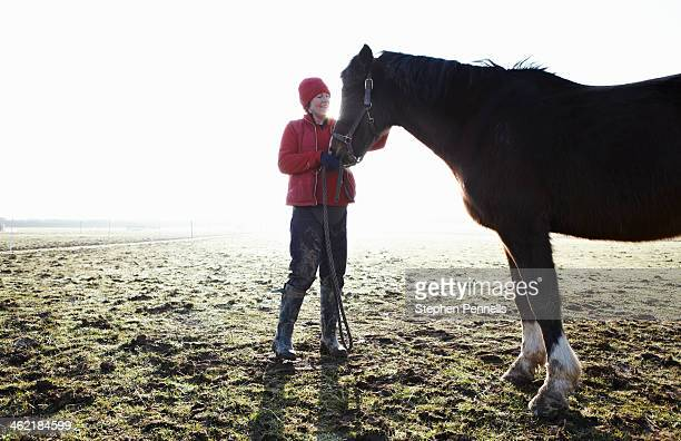 Horse and owner in field