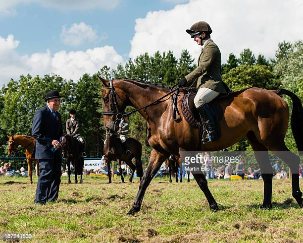 Horse and rider being judged, whilst others await at the Glendale Show on a hot August bank holiday, 2013